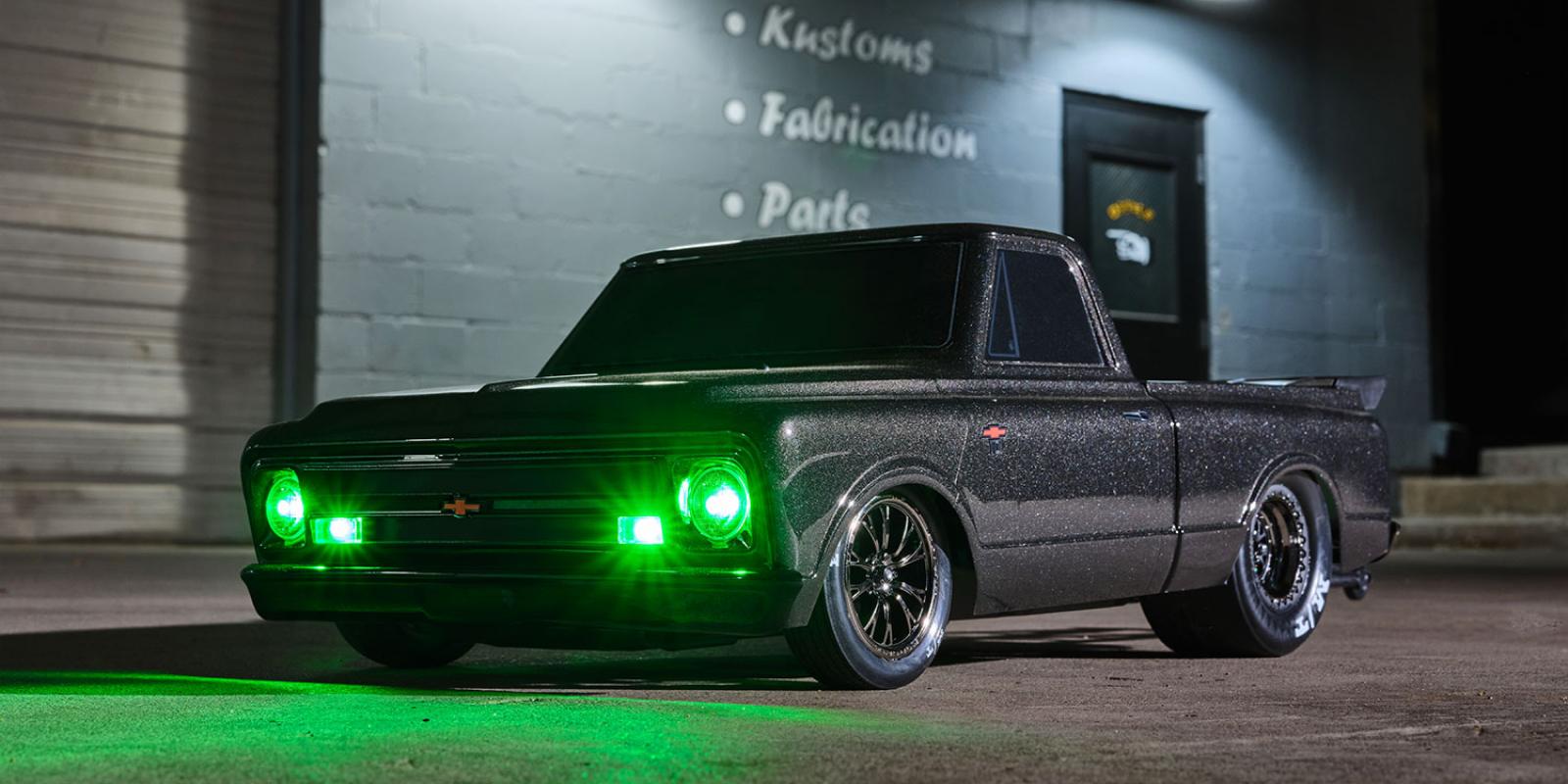 Green LED lights in a black Traxxas Drag Slash